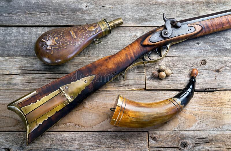 Antique Mountain Man Rifle and Powder flasks stock photo