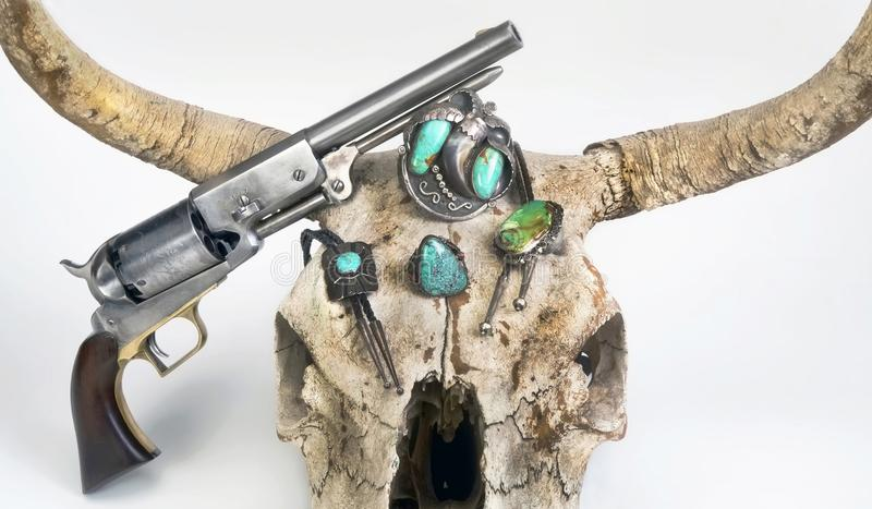 Antique Navajo Jewelry and Pistol. royalty free stock images