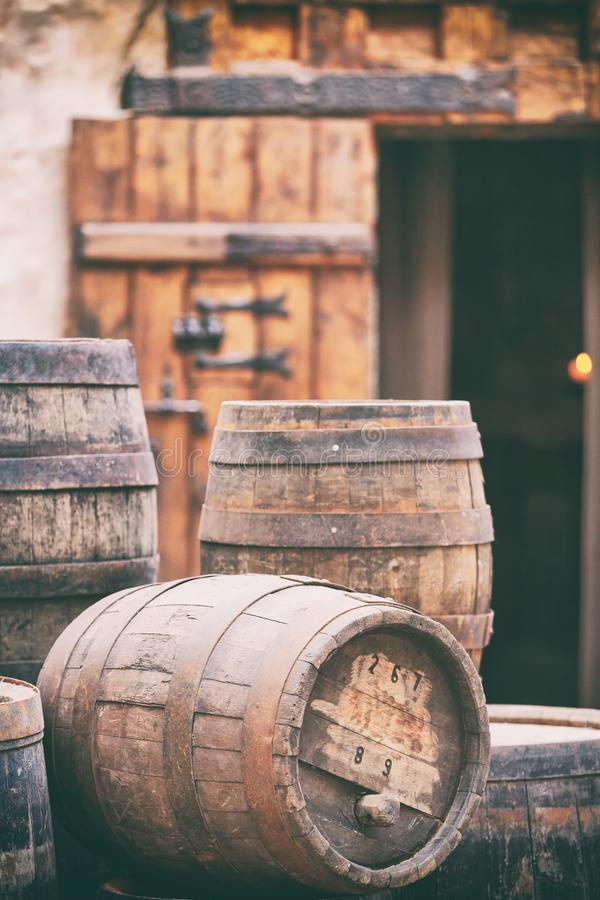 Antique oak barrels with steel hoops royalty free stock photos