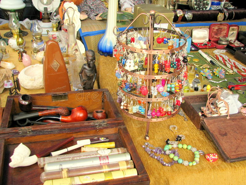 Antique objects for sale in a flea market stock photos
