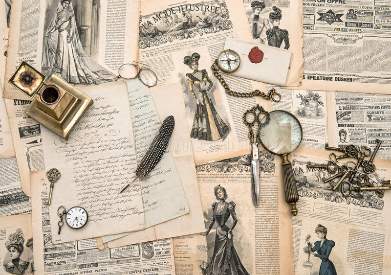 Antique office accessories, writing tools, vintage fashion magazine. For the woman from 1898. retro style toned picture royalty free stock image