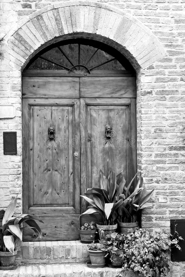 Antique old door Tuscany Italy black white royalty free stock images