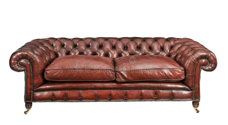 Antique old vintage brown leather studded cushioned couch sofa royalty free stock image