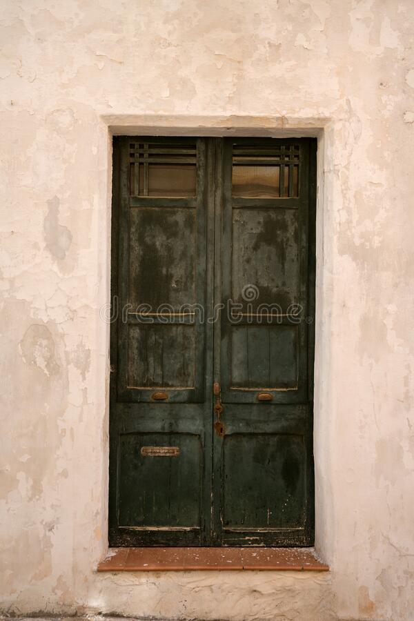 Antique old wooden entrance door as background.  royalty free stock image