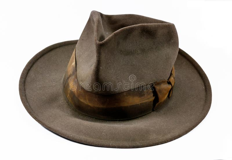 Antique old worn out stained felt hat stock photo