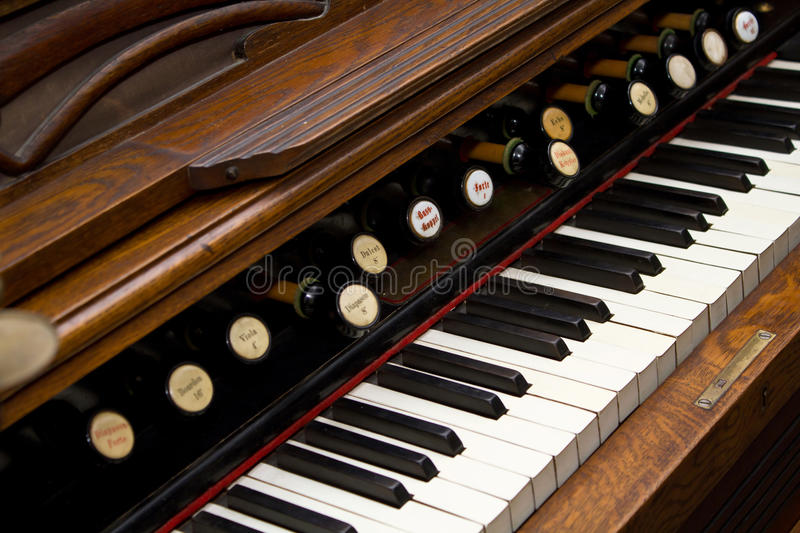 Antique organ keyboard. With shallow depth of field stock photos