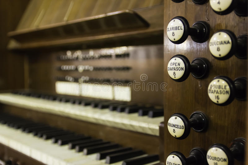 Antique organ manual stops wood stock photography