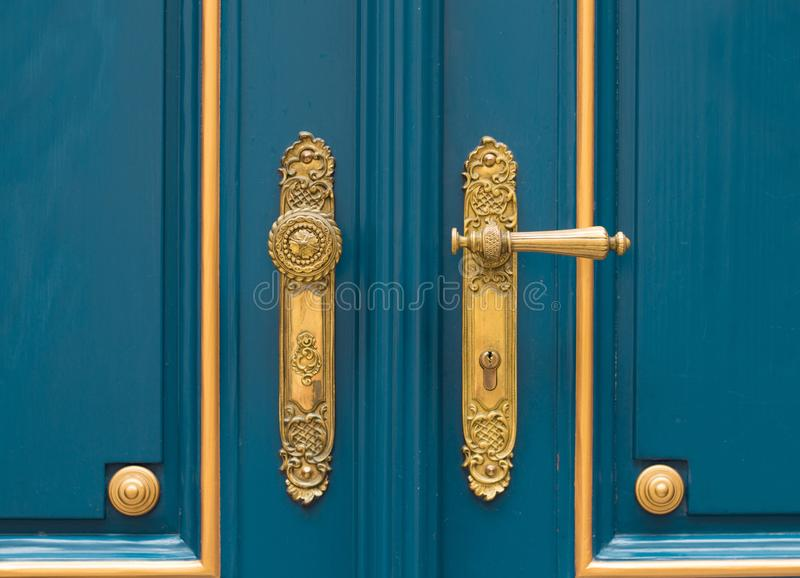 Antique ornate gold door handle royalty free stock photo