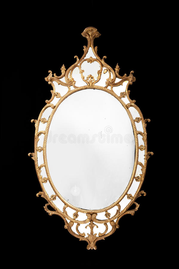 Antique oval mirror gilded with original glass royalty free stock photo