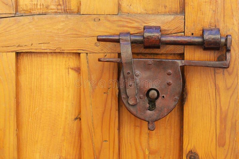 Antique padlock. On a vintage wooden door taken in Europe royalty free stock image
