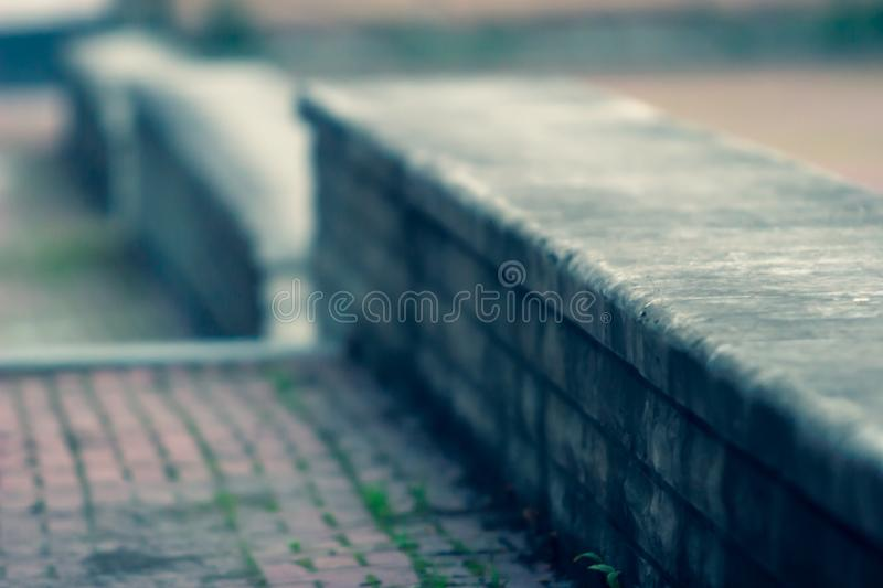 Antique parapet leaving the distance with a blurred focus. Defocused. royalty free stock images