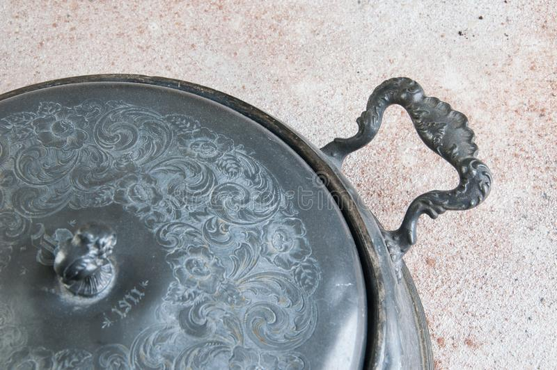 Antique pewter chafing dish holder. Candle warming stand for chafing dish, buffet table dish warmer, food photography props on a concrete background. Copy space stock images