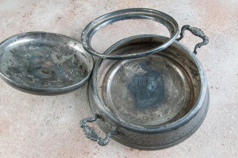 Antique pewter chafing dish holder. Candle warming stand for chafing dish, buffet table dish warmer, food photography props on a concrete background. Copy space stock photos
