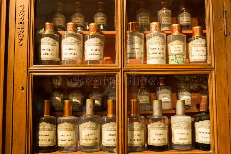 Antique pharmacy, Beaune, France. Medical supplies at the historic 15th century hospital Hotel Dieu in Beaune, France royalty free stock photography