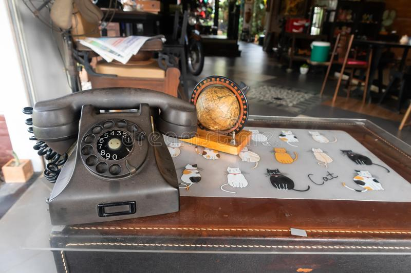 Antique phone with newspaper. On the table royalty free stock photography
