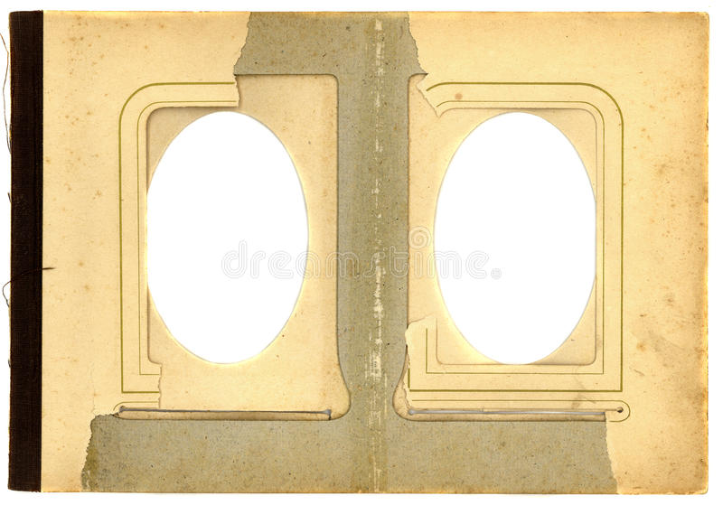 Antique photo album page background with two isolated oval hole royalty free stock photography
