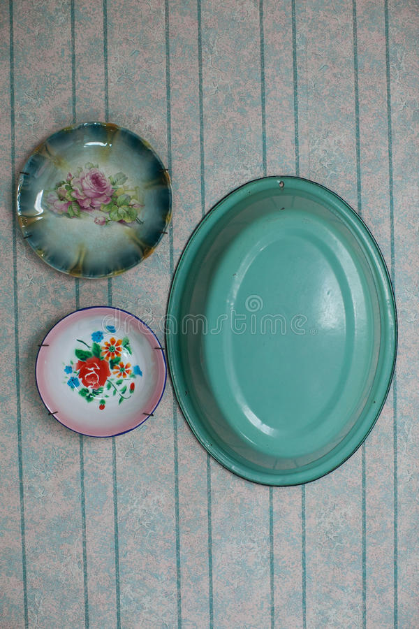 Antique plates on wall royalty free stock photos
