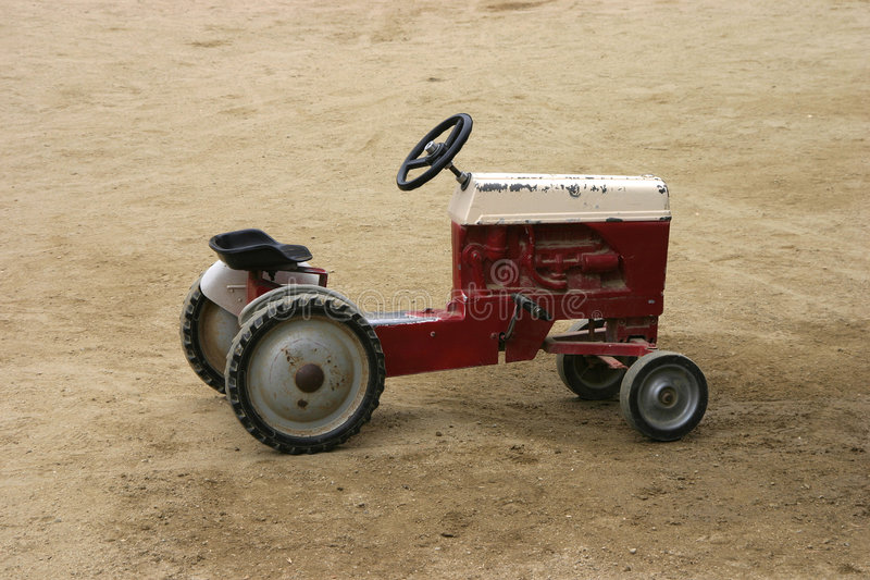 Antique Play Tractor stock images