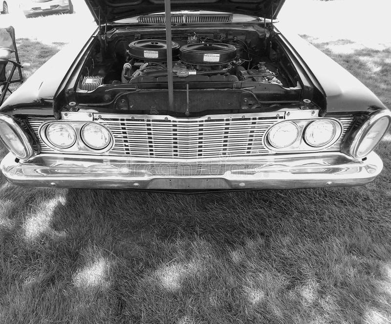An Antique Plymouth Fury. An1960 era Plymouth Fury with a 426 Hemi, and two four barrel carborators stock image