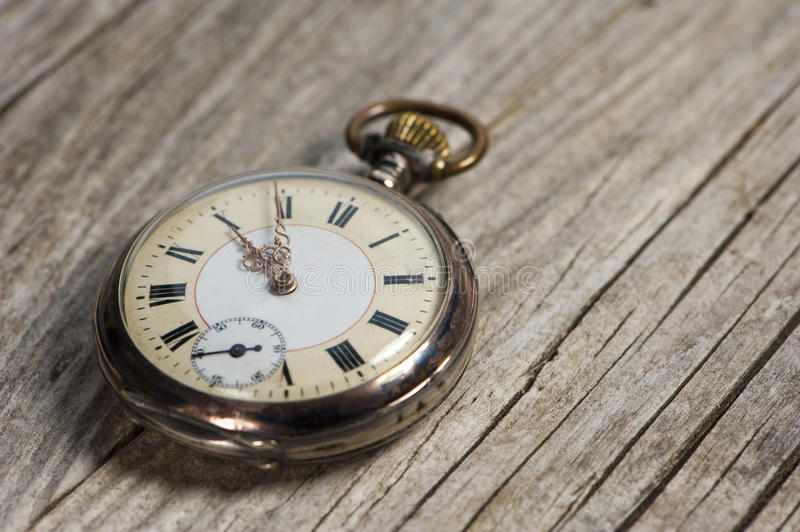 Antique pocket watch. On wooden background royalty free stock photos