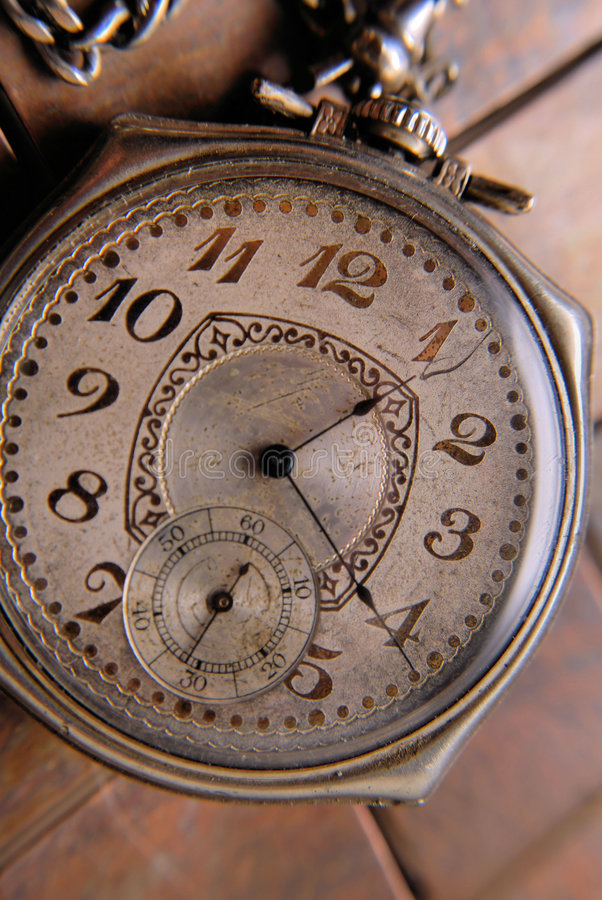Antique pocket watch. A man's old, well used, pocket watch royalty free stock photography
