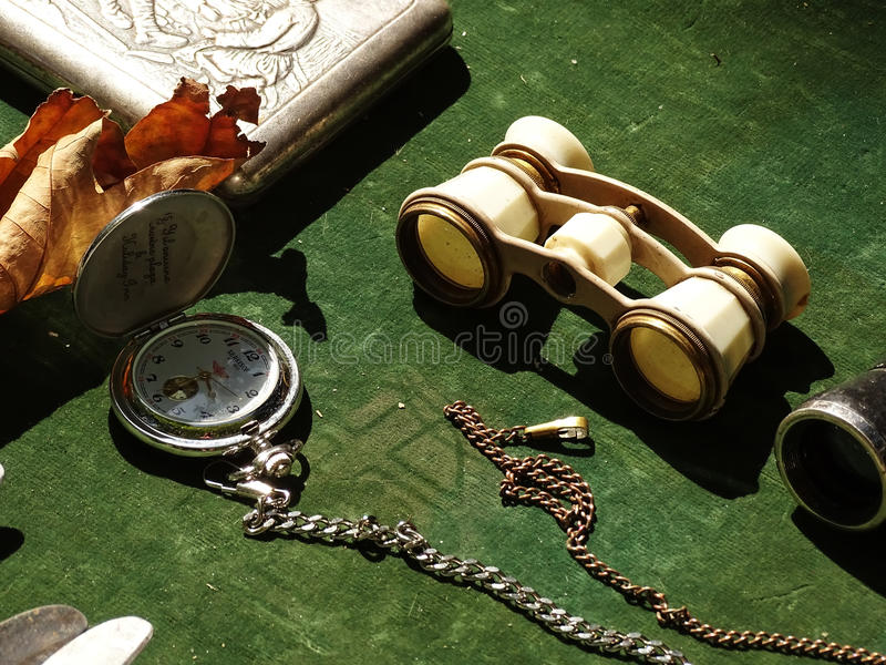 Antique pocket watch, book and binoculars royalty free stock image