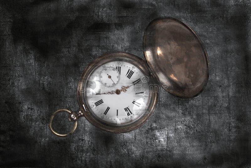 Antique pocket watch on a dark vintage background. Antique pocket watch on dark gray vintage background stock photos