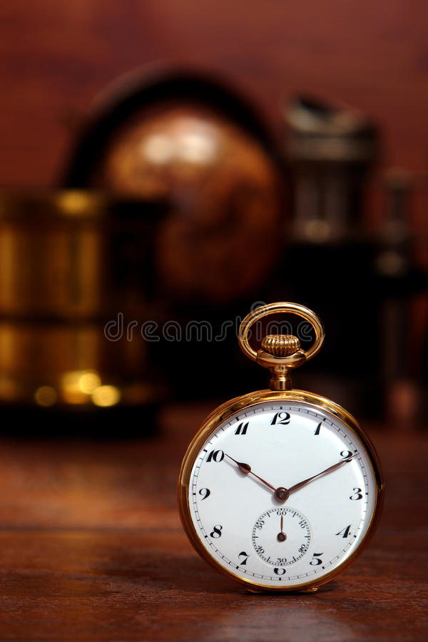 Antique Pocket Watch in Old Vintage Decor royalty free stock images