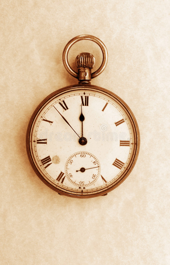 Antique pocket watch sepia. Antique pocket watch on parchment sepia stock photography