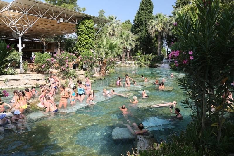 Antique Pool in Hierapolis Ancient City, Turkey. DENIZLI, TURKEY - JUNE 16, 2017: People in Antique Pool of Hierapolis Ancient City in Pamukkale. Pool was shaped royalty free stock photos