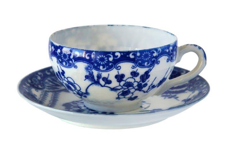 Antique porcelain cup and saucer. An antique porcelain cup and saucer isolated on white background stock images