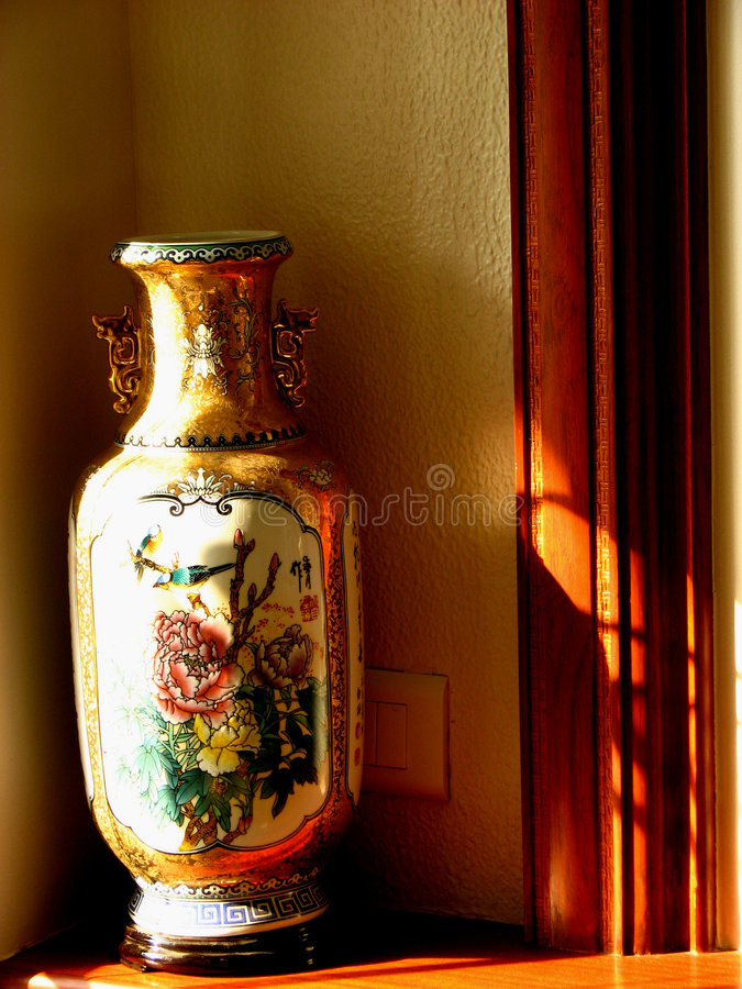 Antique Pot. A beautiful antique pot in a living room royalty free stock photography