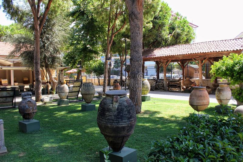Antique pots and amphoras - an exhibition in the courtyard of the Alanya Archaeological Museum Turkey.  stock images