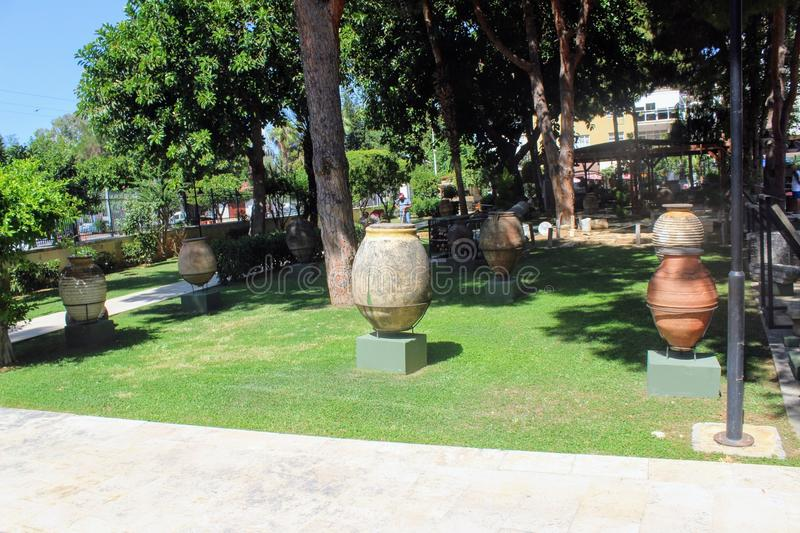 Antique pots and amphoras - an exhibition in the courtyard of the Alanya Archaeological Museum Turkey.  royalty free stock image
