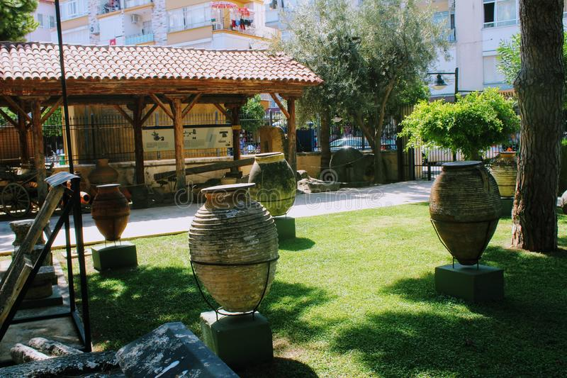Antique pots and amphoras - an exhibition in the courtyard of the Alanya Archaeological Museum Turkey.  royalty free stock images