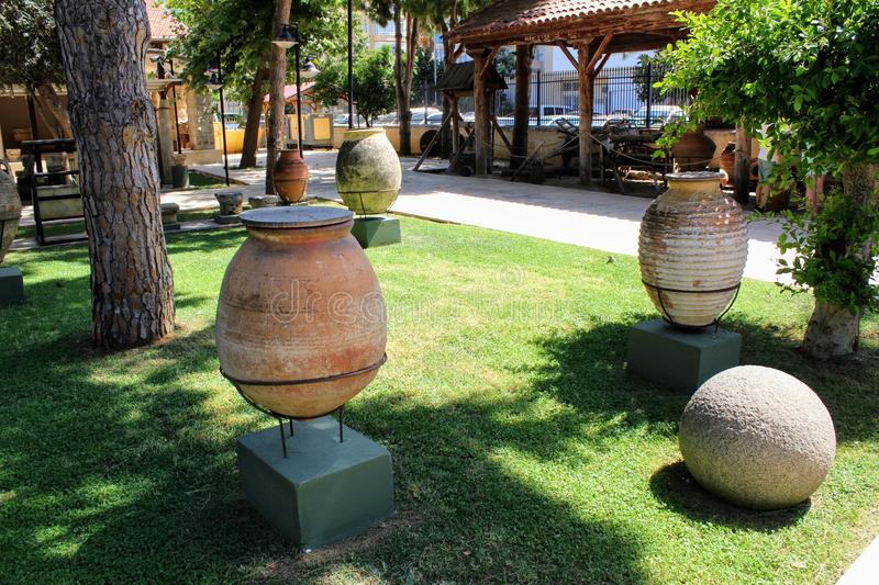 Antique pots and amphoras - an exhibition in the courtyard of the Alanya Archaeological Museum Turkey.  stock photography