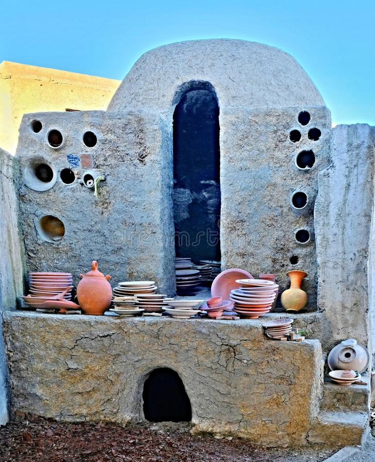 Antique pottery kiln for making and firing various ceramic and earthenware dishes made of clay in the city of Fez in Morocco stock photography