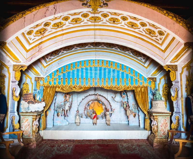 Antique puppetry theatre. Stresa, Italy, May 22 2017 - an antique puppetry theatre decorated with a golden curtain royalty free stock photography