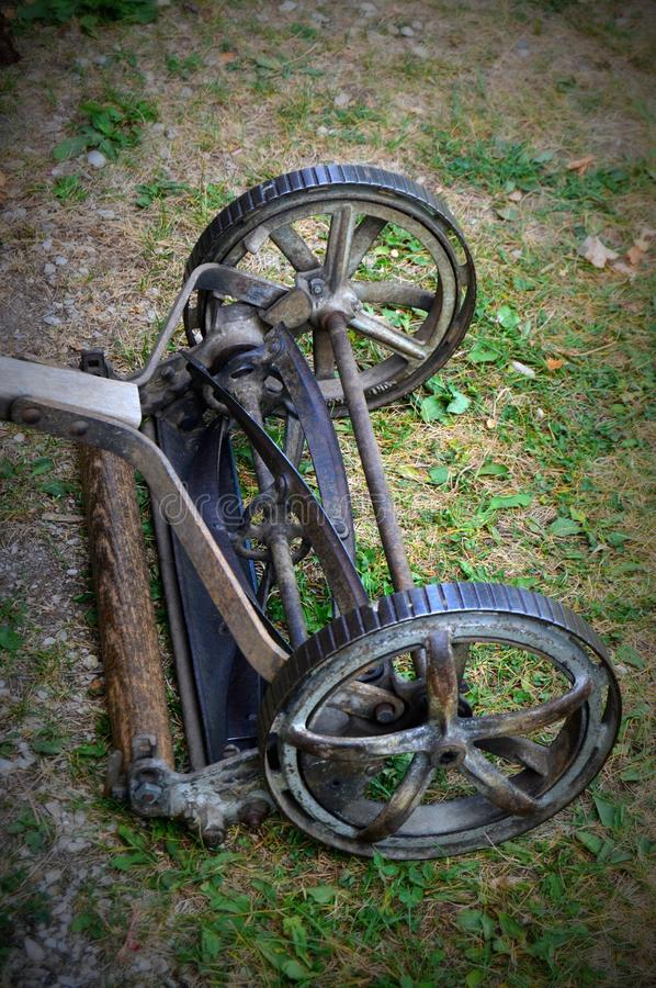 Antique Push Lawn Mower. Picture of an antique push lawn mower at Old World Wisconsin stock image