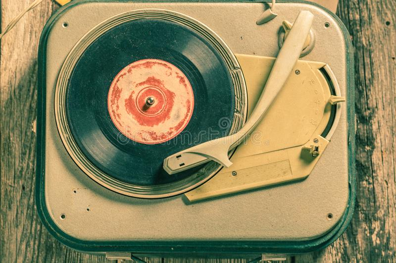 Antique record player and few vinyl records royalty free stock photography