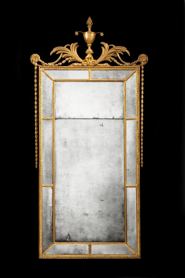 Antique rectangular mirror gilded with original glass stock image