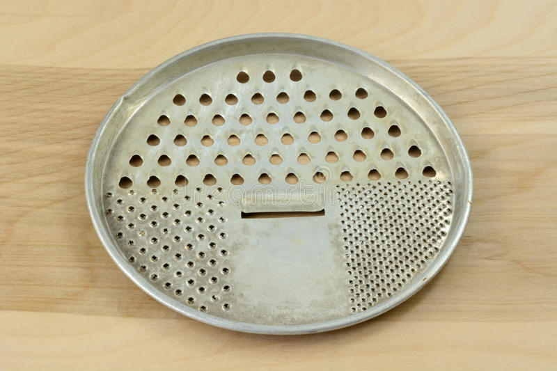 Antique retro flat round cheese grater royalty free stock photos