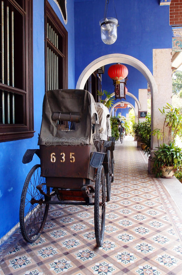 Antique rickshaw on the streets of Penang. stock photos
