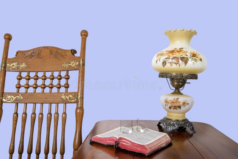 Antique rocking chair and Bible stock image