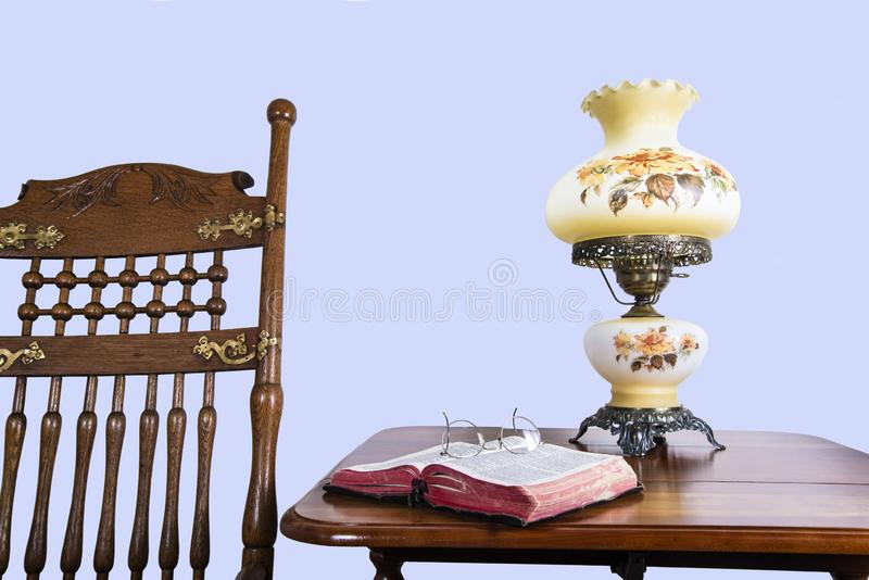 Antique rocking chair and Bible royalty free stock photo