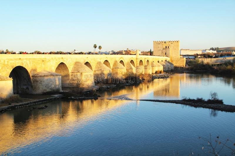 Antique roman bridge in Cordoba. Beautiful antique roman bridge over the Guadalquivir river at sunset in Cordoba , Spain stock photos
