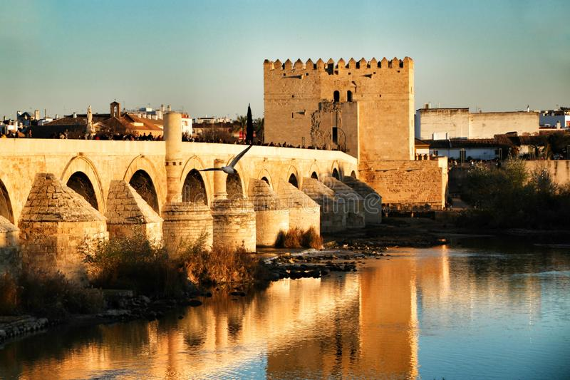 Antique roman bridge in Cordoba. Beautiful antique roman bridge over the Guadalquivir river at sunset in Cordoba , Spain stock photo