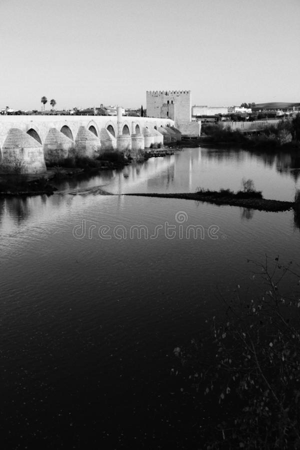 Antique roman bridge in Cordoba. Beautiful antique roman bridge over the Guadalquivir river at sunset in Cordoba , Spain royalty free stock image