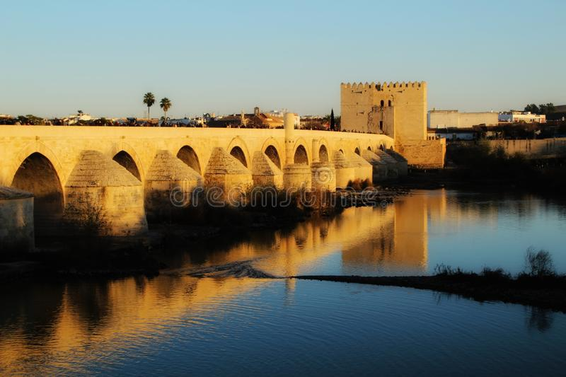 Antique roman bridge in Cordoba. Beautiful antique roman bridge over the Guadalquivir river at sunset in Cordoba , Spain royalty free stock images