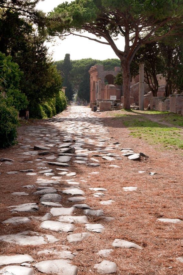 Antique roman way at Ostia Antica Rome. Antique roman way and buildings at Ostia Antica - Italy - Rome stock images